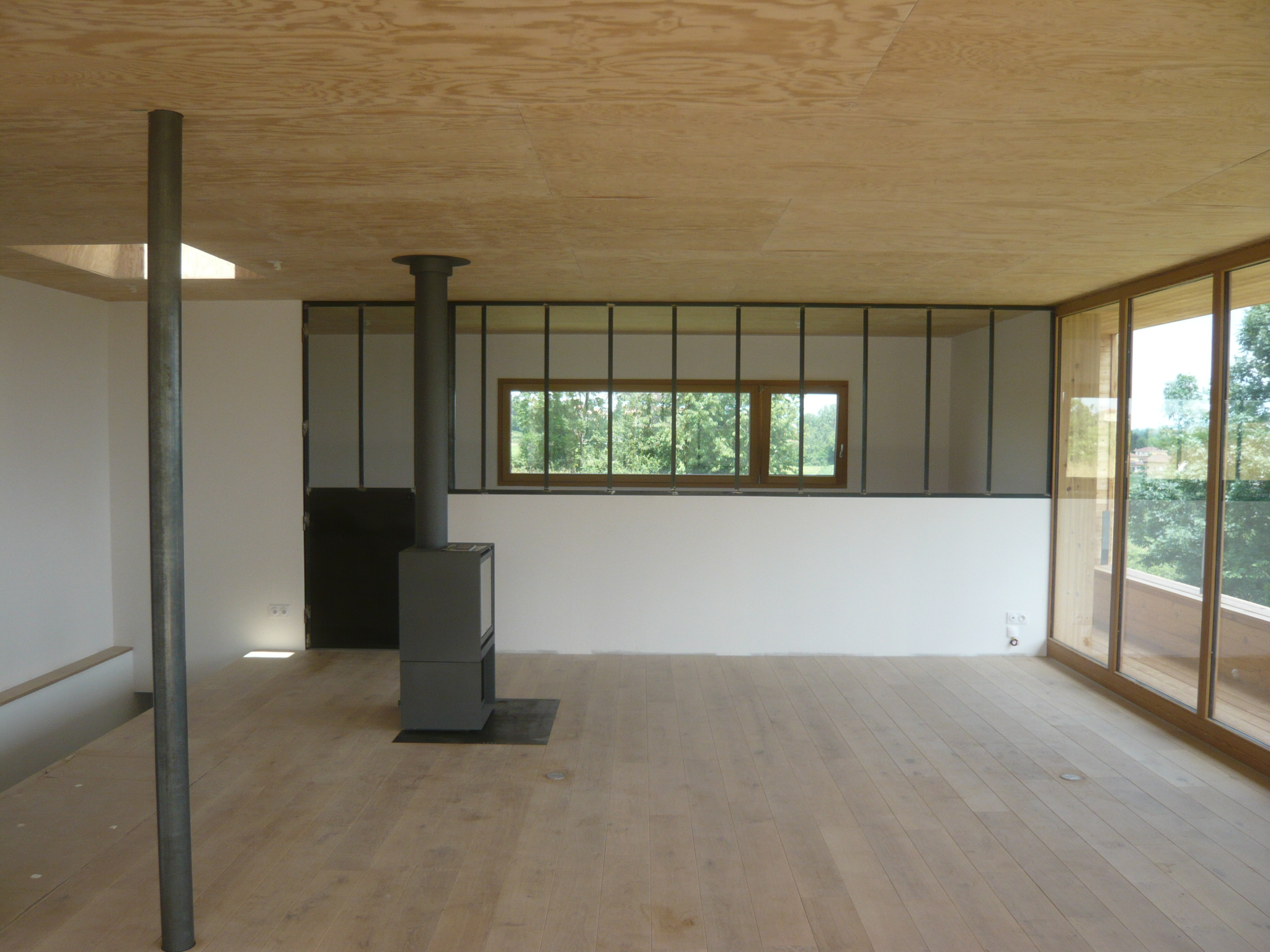 Interieur maison bois contemporaine maison eko for Constructeur maison bois contemporaine